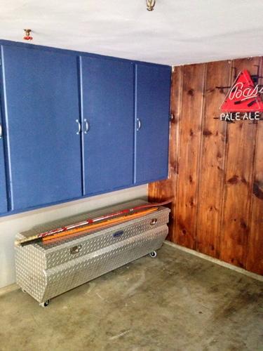 mancave-storage-idea-truck-tool-box-turned-garage-storage-for-sports-equipment.jpg