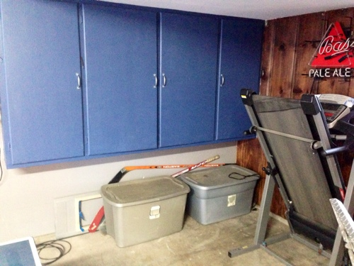 organizing-messy-garage-and-sports-equipment-with-metal-storage-truck-tool-box.jpg