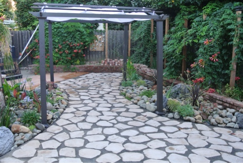 small-water-wise-backyard-with-pergola-and-flagstone-patio-.jpg