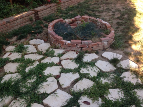 ugly-backyard-before-pic-weeds-brick-and-flagstone.jpg
