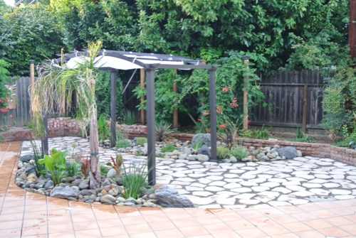 water-wise-small-backyard-with-flagstone-patio-pergola-and-drought-tolerant-plants-small-california-backyard-with-big-dogs.jpg